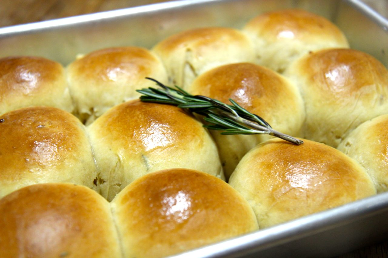 Rosemary garlic rolls topped with butter and baked to a golden brown perfection