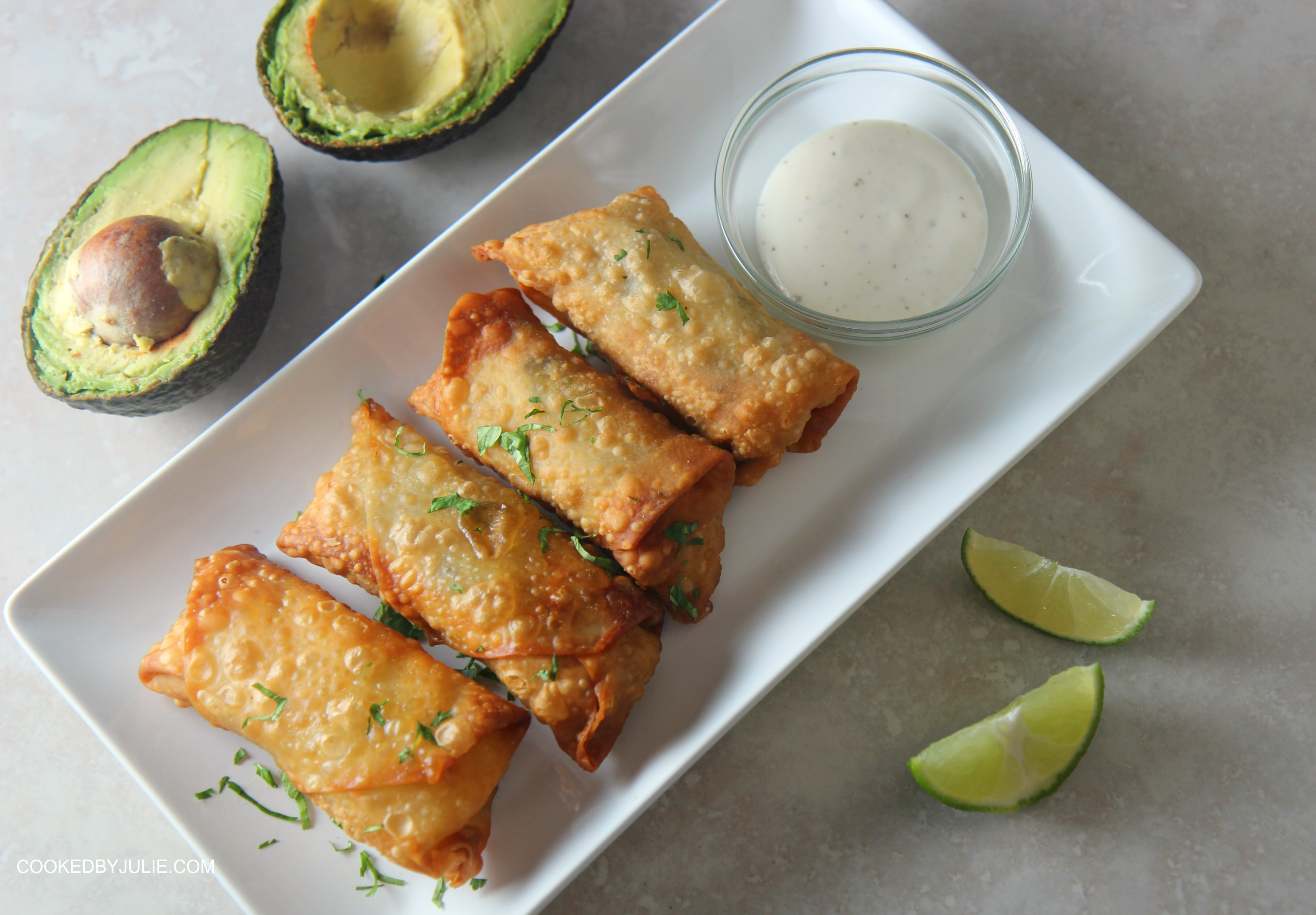 Serve these chicken avocado egg rolls with some ranch dipping sauce and lime wedges.