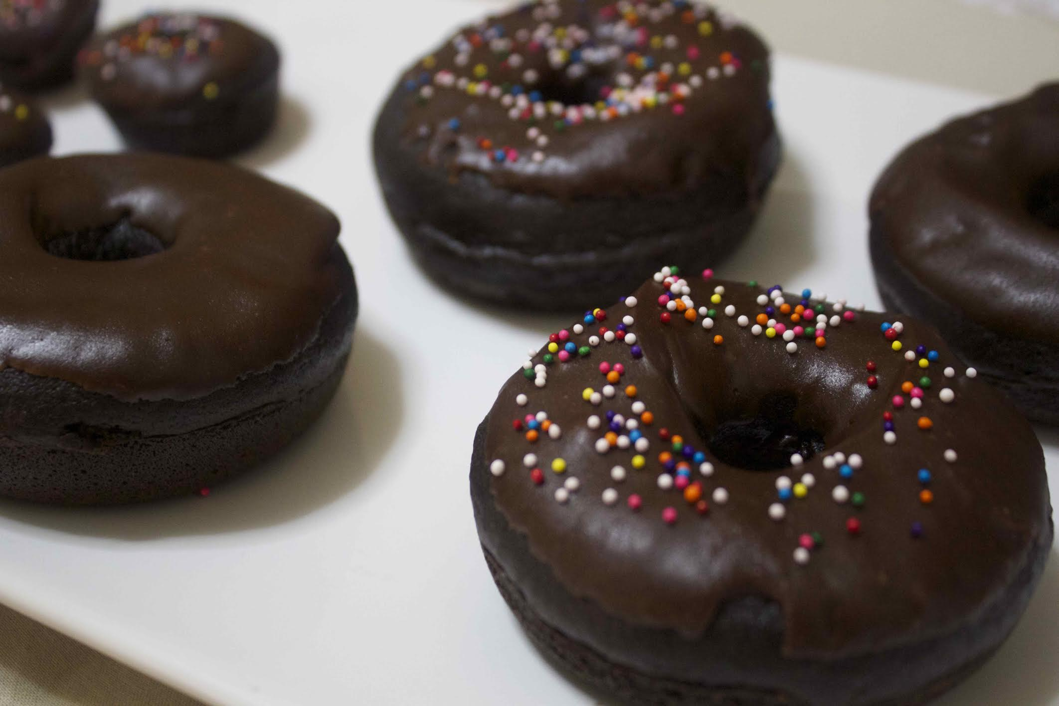 chocolate baked donuts on a white plate