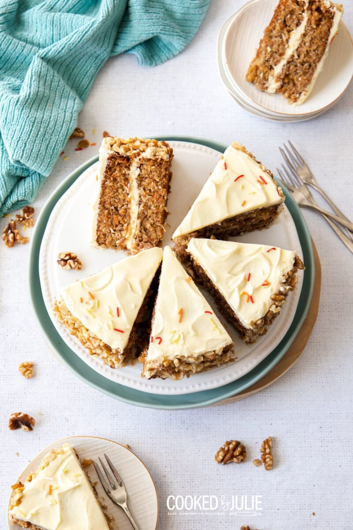 seven slices of carrot cake with three forks
