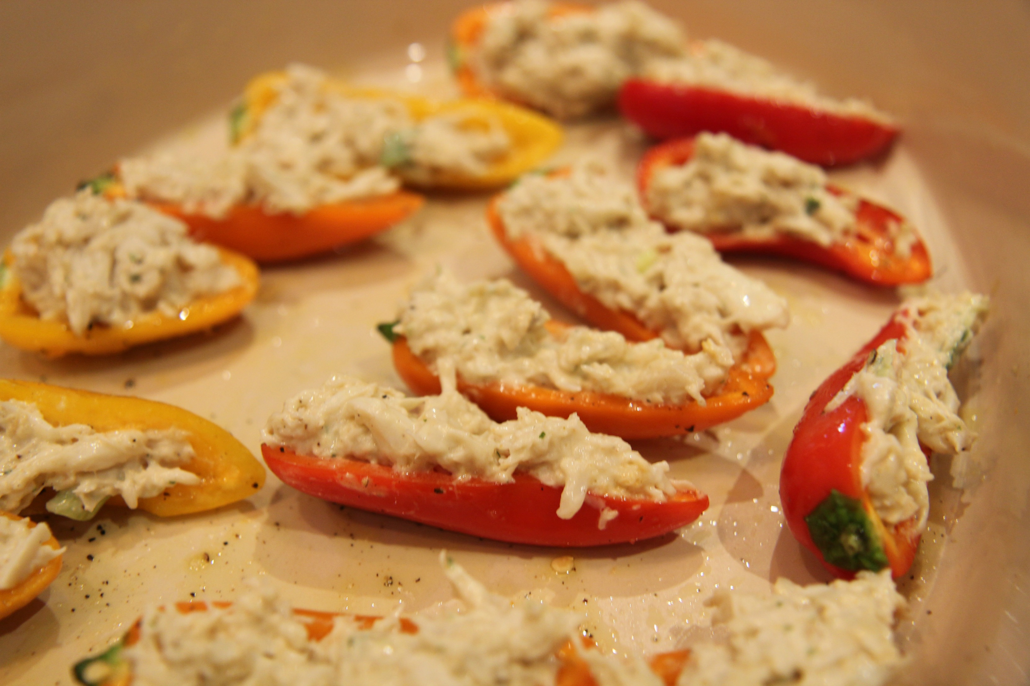 Drizzle the peppers with a little oil after filling them.