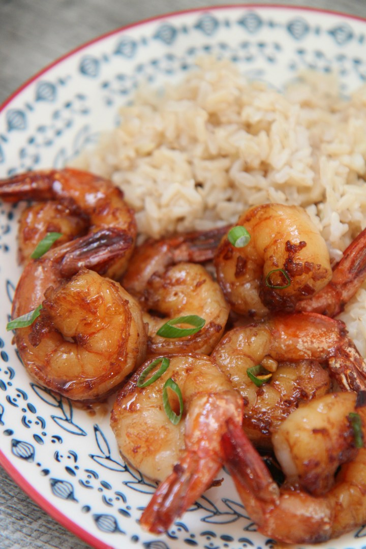 honey garlic shrimp with scallions and brown rice.