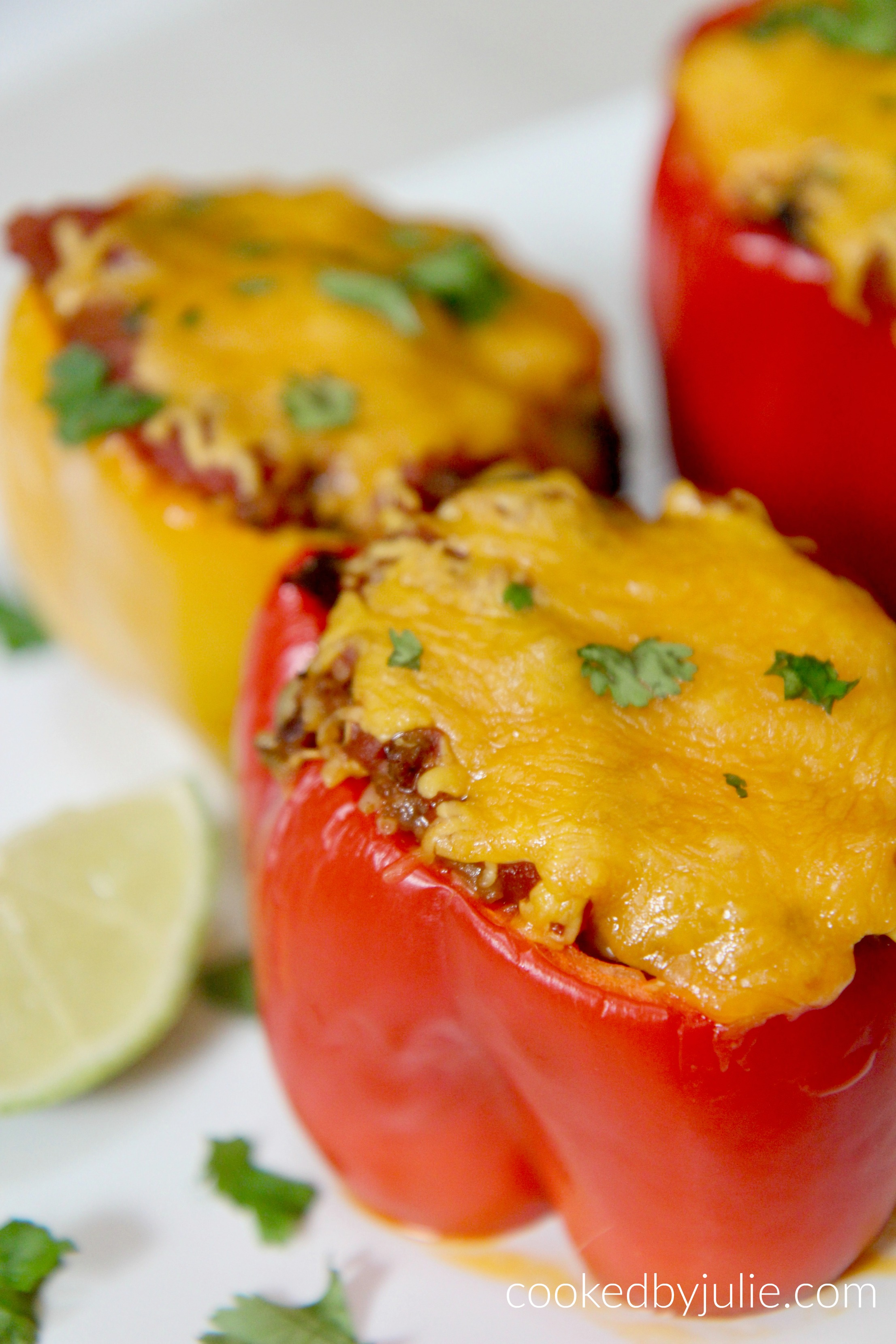 These taco stuffed peppers are a super easy, cheesy, and delicious weeknight dinner