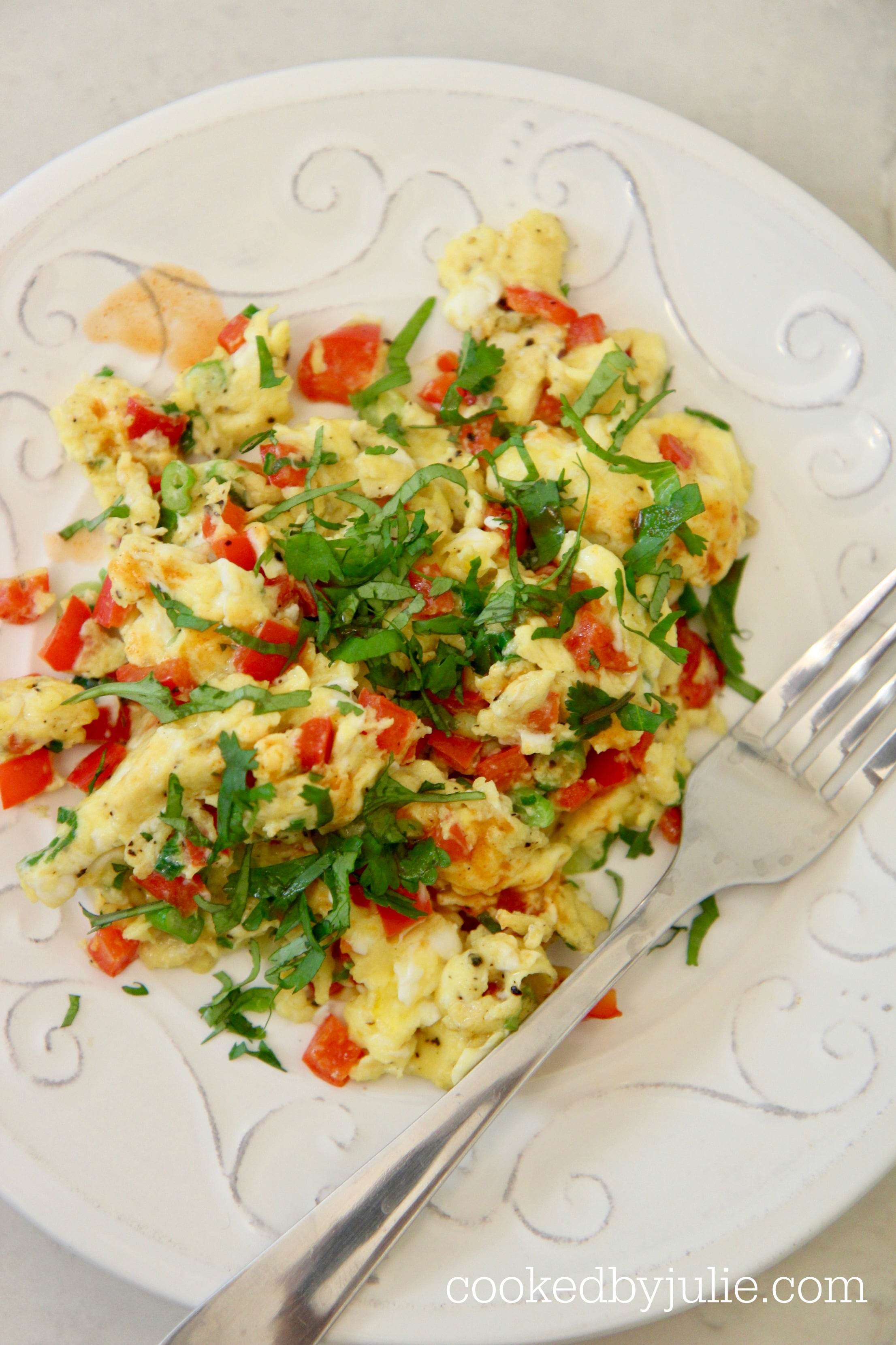 scrambled eggs with onions, peppers, cilantro, and hot sauce.