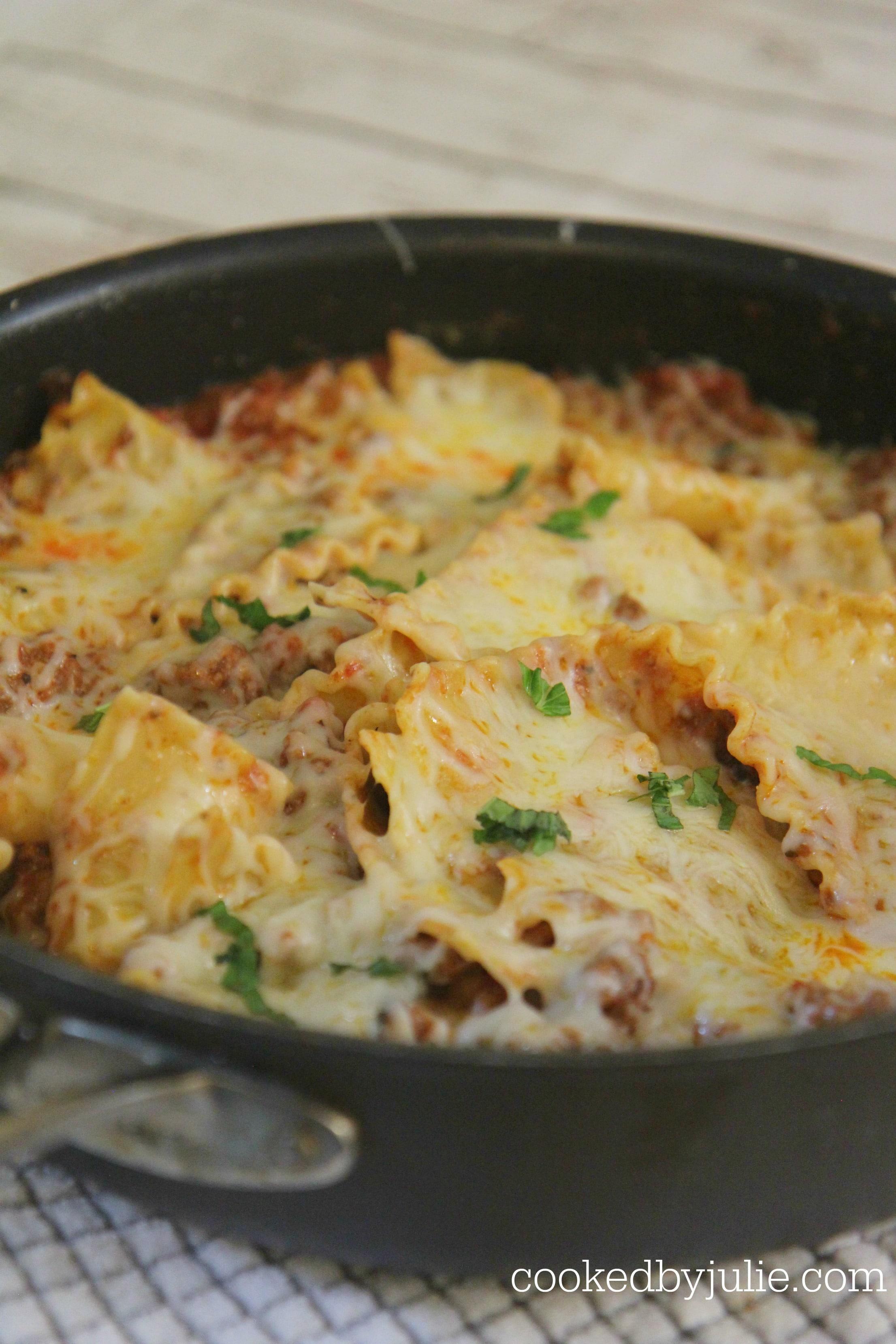 lasagna skillet with fresh basil and cheese.