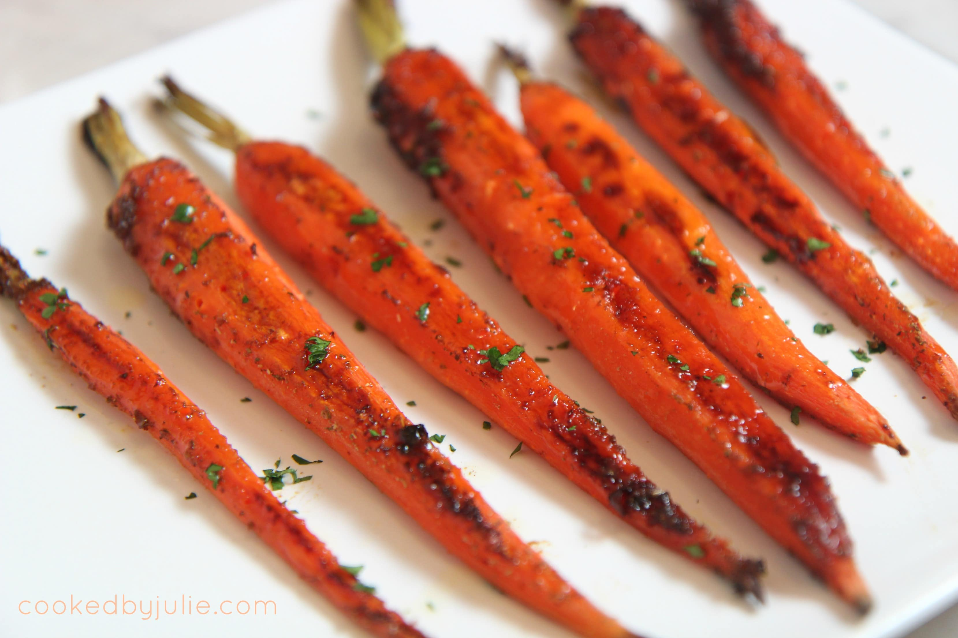 honey garlic carrots sprinkled with fresh parsley - a delicious and easy holiday side dish