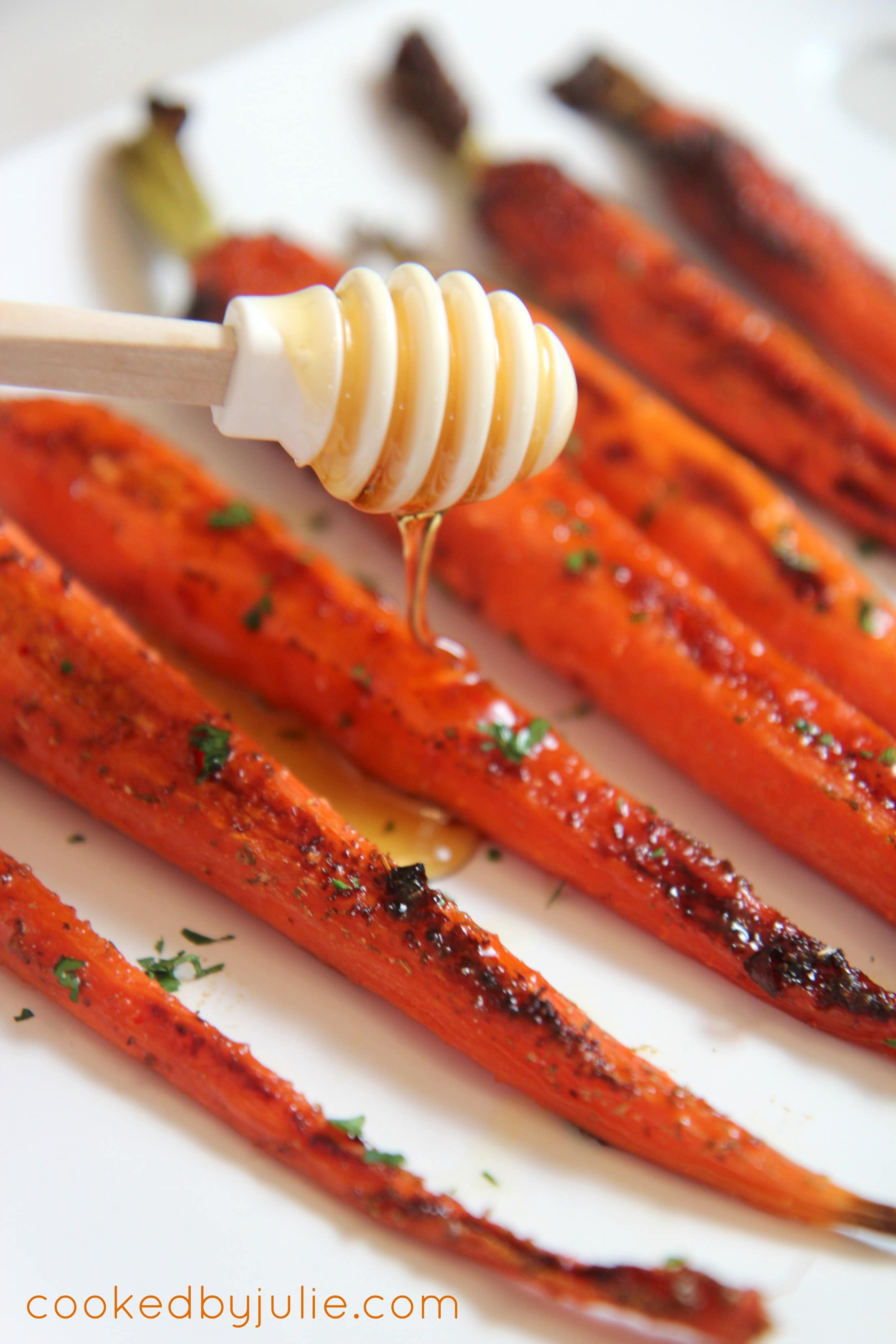honey glazed garlic roasted carrots make a simple holiday side dish that's ready in minutes