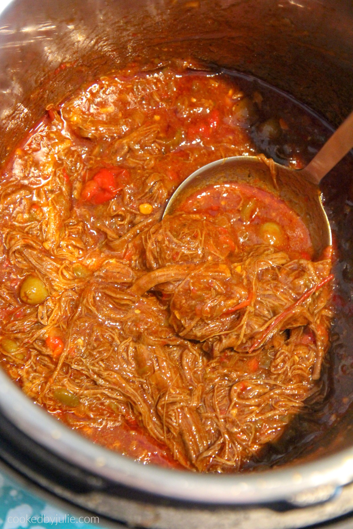 shredded flank steak in a tomato broth