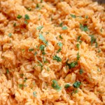 a large serving of Spanish rice and fresh cilantro