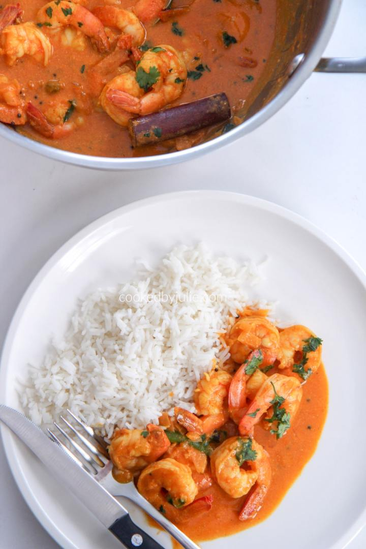 rice and coconut shrimp curry on a white plate and a pot of shrimp curry