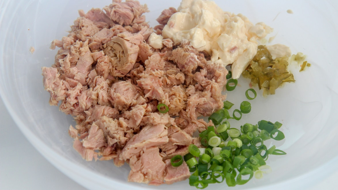 canned tuna, scallions, mayo, and sweet relish in a white bowl