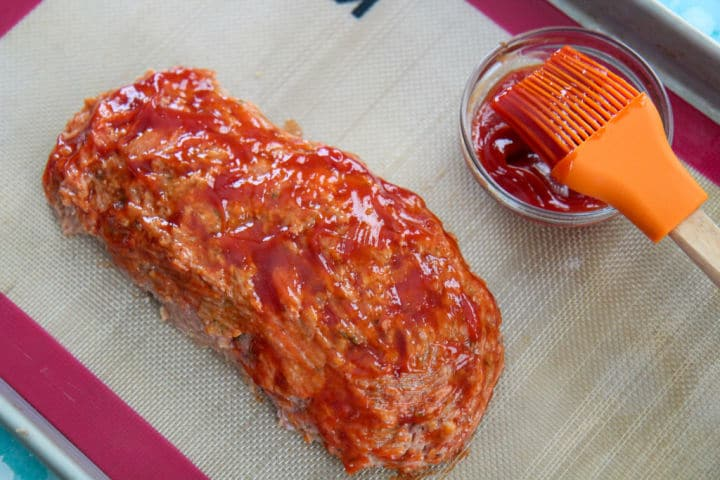 turkey meatloaf with a ketchup glaze on a baking sheet
