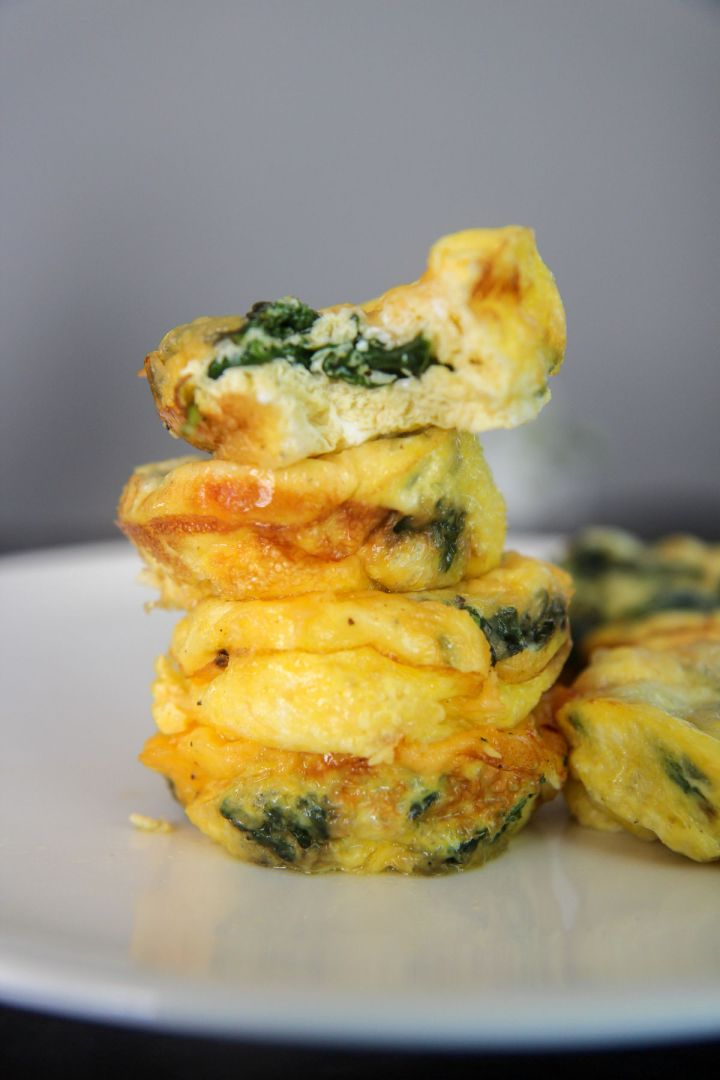 egg muffins stacked on a white plate