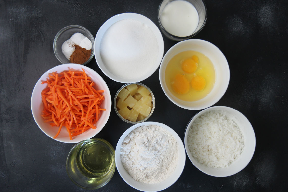 nine small bowls with ingredients on a black surface