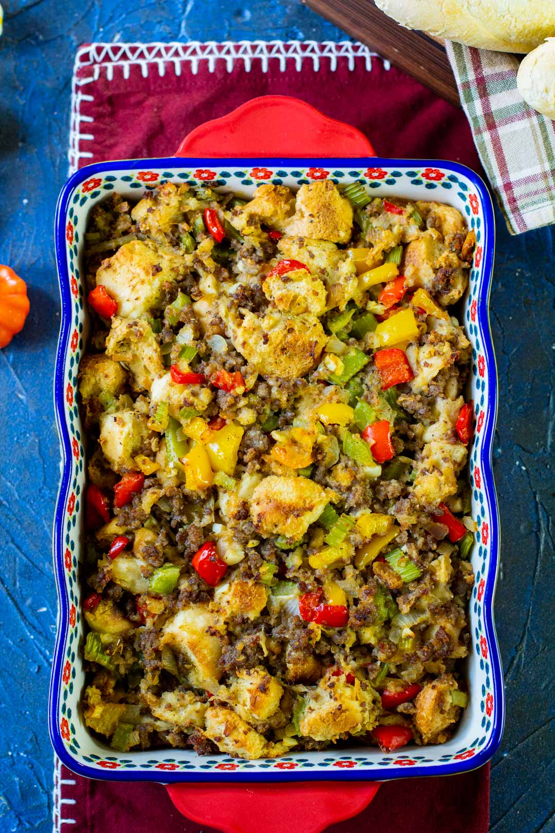 sausage stuffing in a blue and red casserole dish