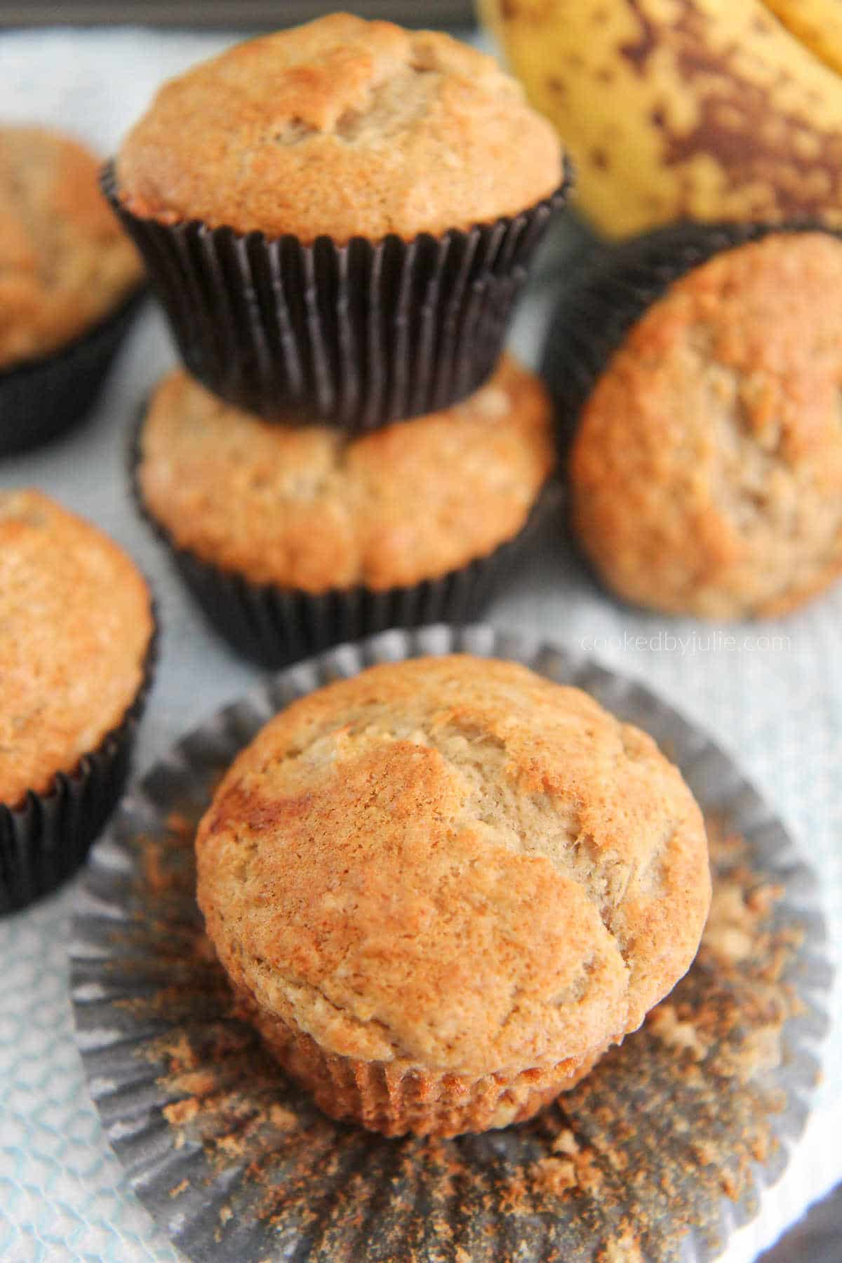 banana muffins with bananas in the background