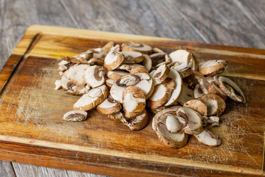 sliced mushrooms on a wooden board
