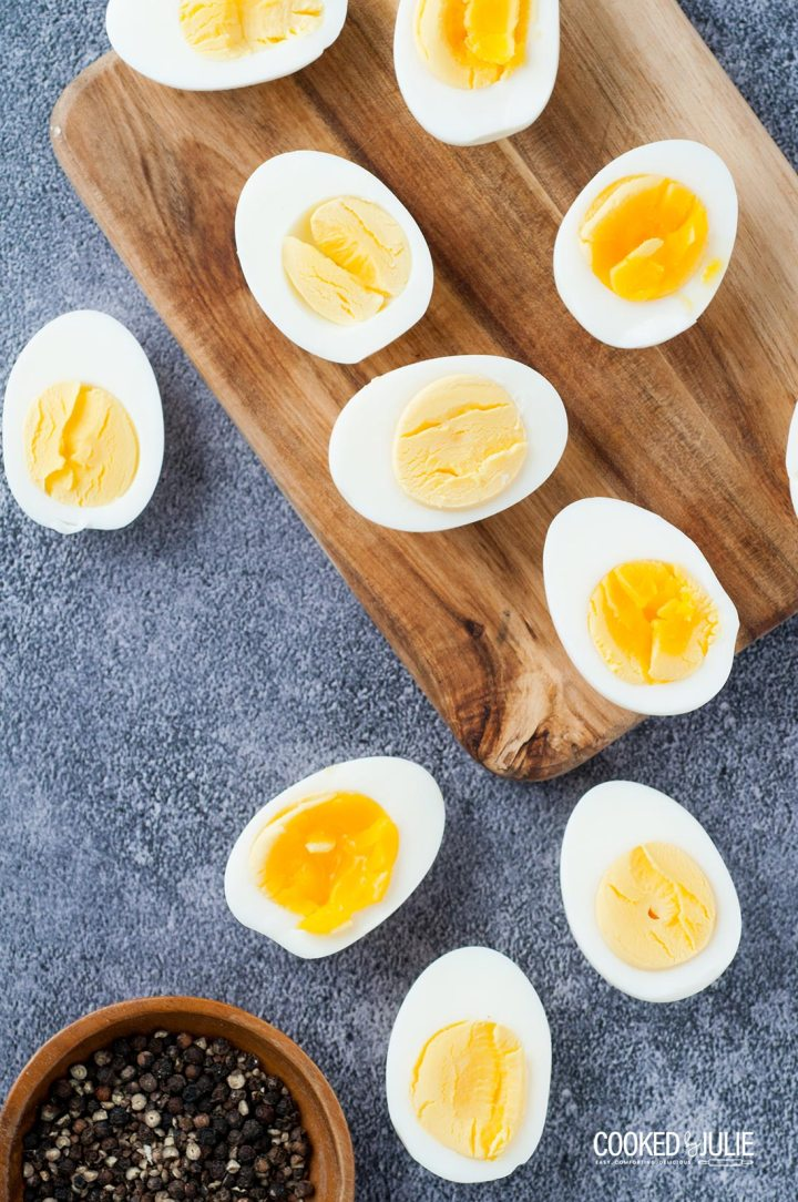 scattered boiled egg halves with a pinch bowl of salt and pepper