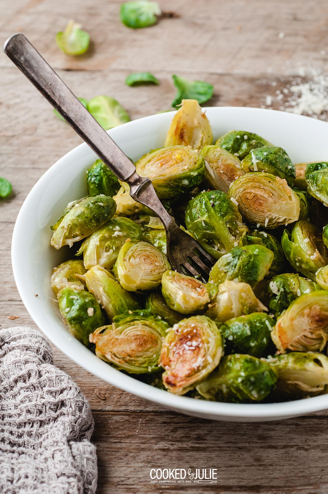 roasted parmesan Brussel sprouts in a white bowl