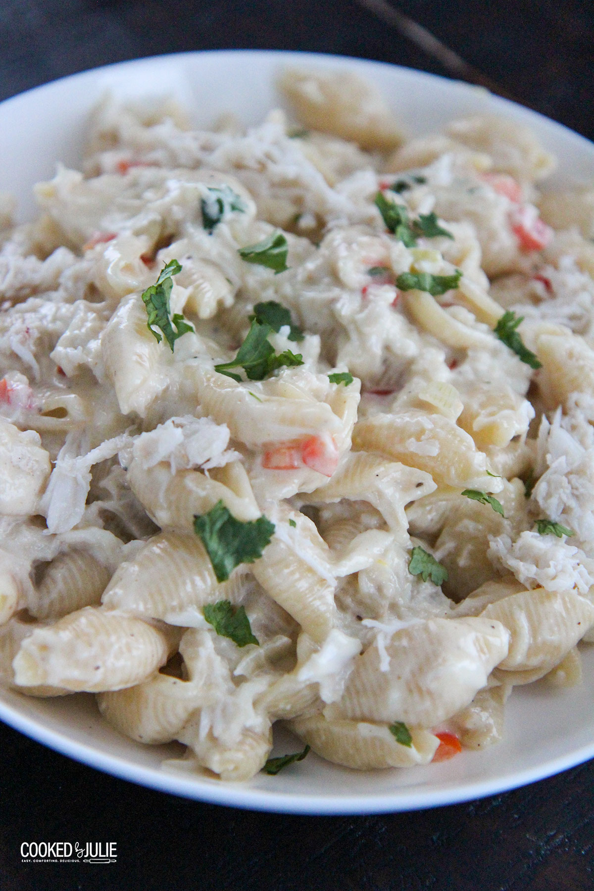 cheesy crab Alfredo pasta in a white bowl