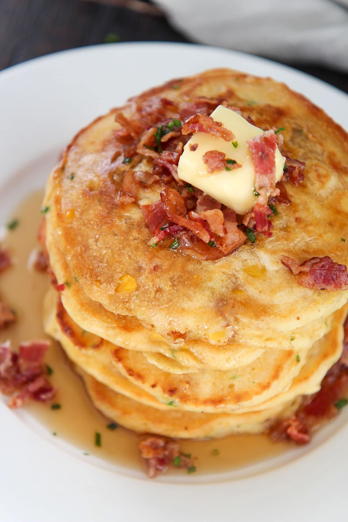 five corn cakes on a plate.