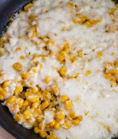 corn and cheese in a black skillet.