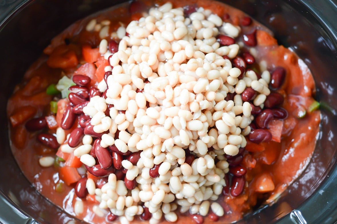 beans, tomatoes, sauce, spices, and ground beef in the crockpot.
