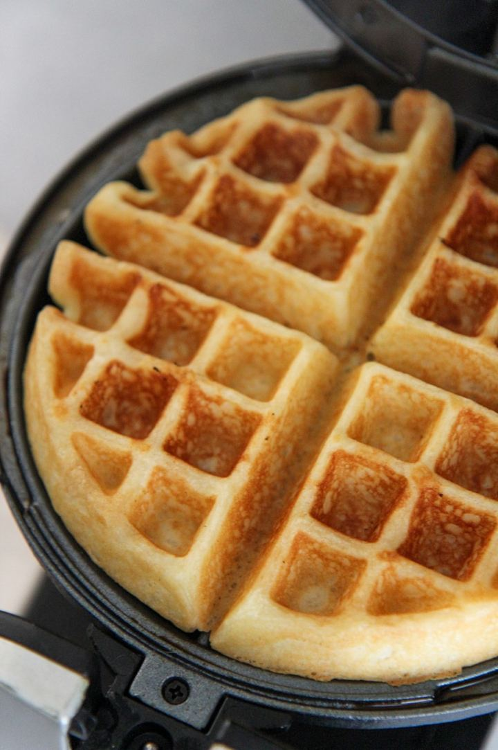 cooked waffle in a waffle iron.