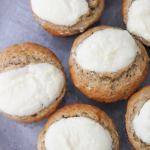 cream cheese banana muffins up close on a gray plate.