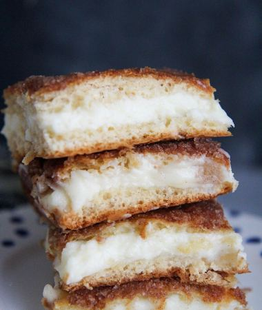 four cheesecake bars stacked on top of each other