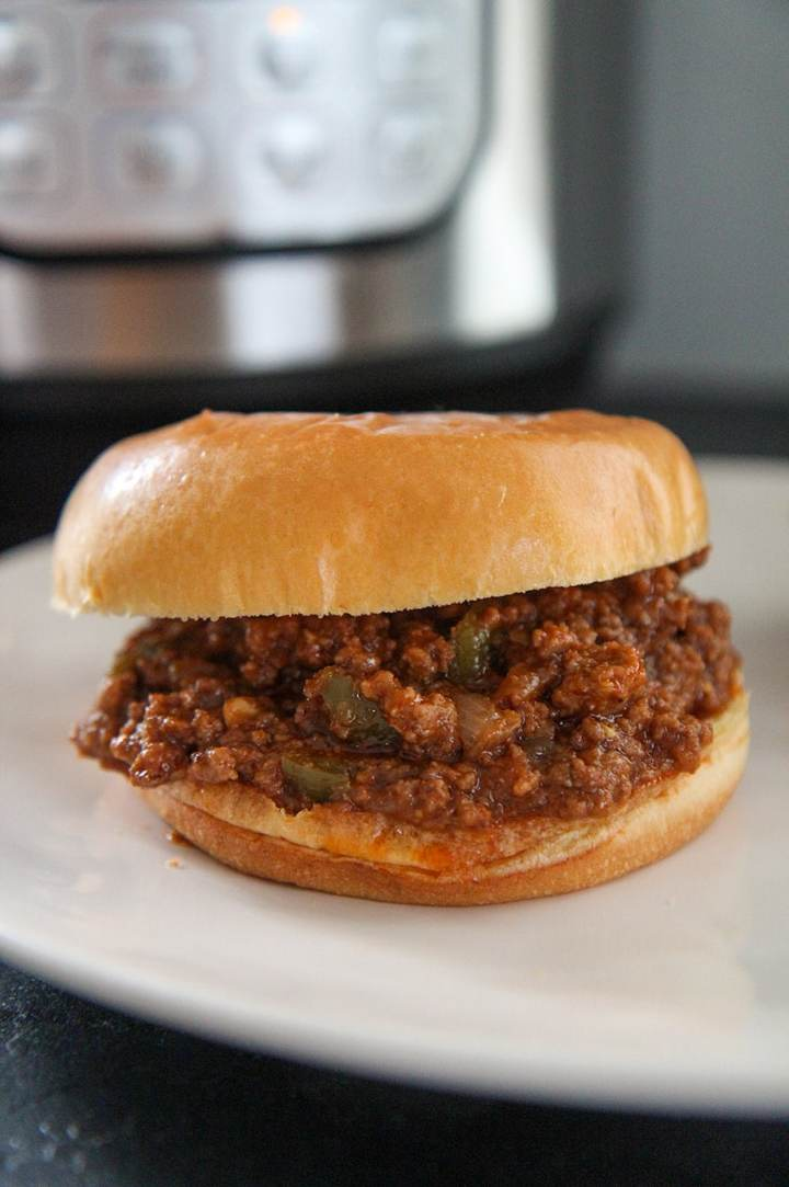 a sloppy joe sandwich with an instant pot in the background.
