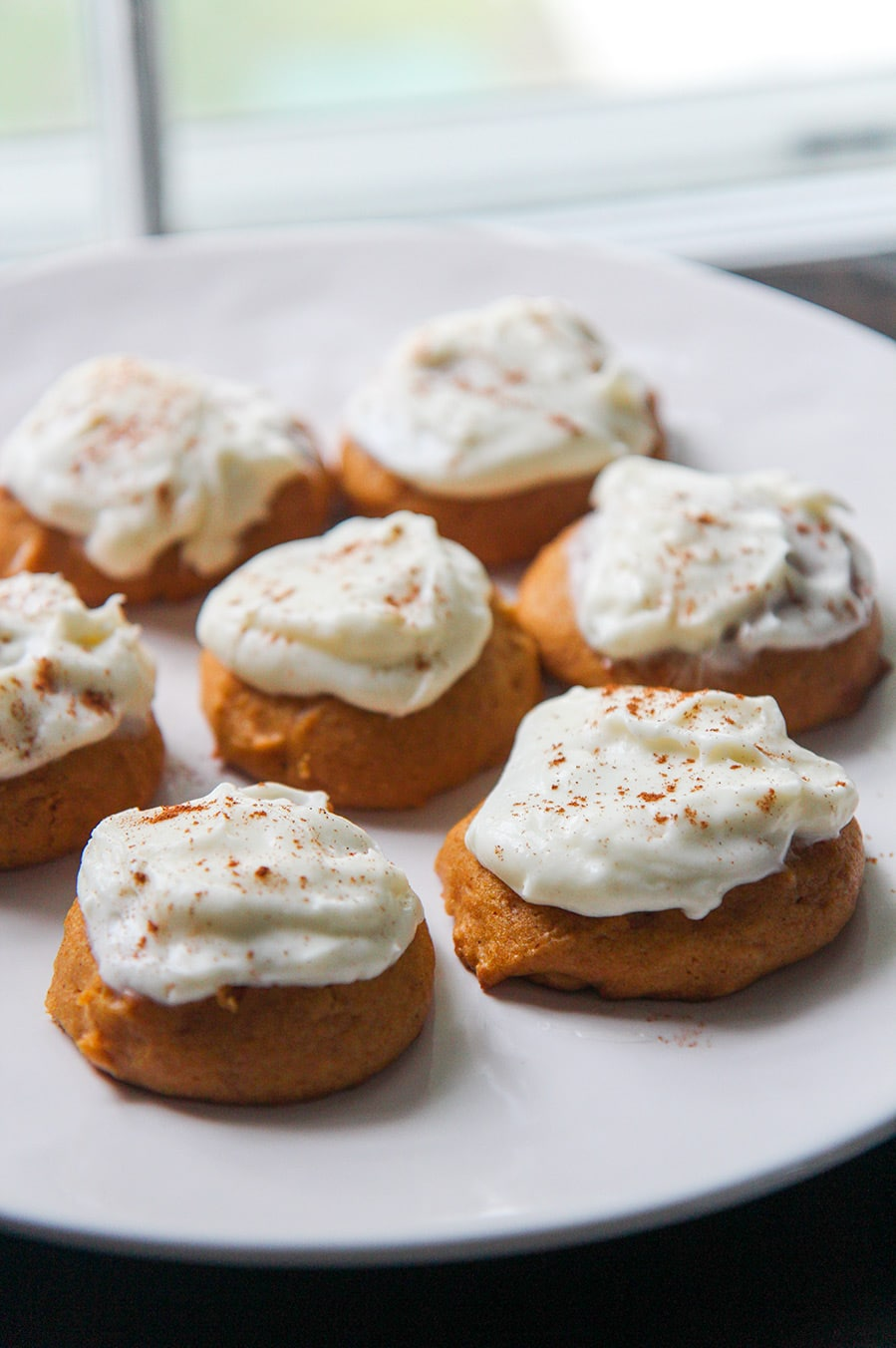 pumpkin cookies on a white plate.