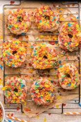 8 fruity pebble donuts on a wire rack