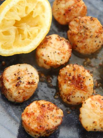 air fryer scallops with a lemon on the side.