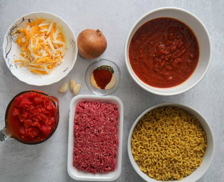 what goes into crockpot goulash. Ingredients in bowls.