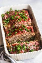 sliced meatloaf with fresh parsley on top.