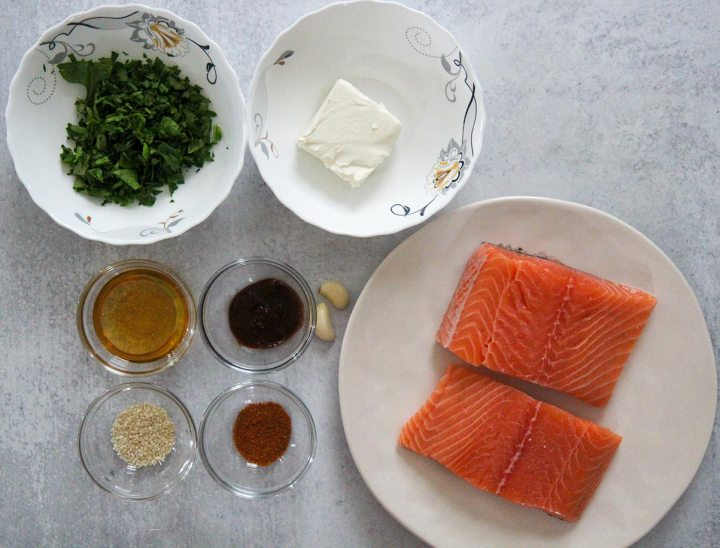 what goes into spinach stuffed salmon. Ingredients on a plate and bowls.