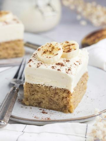 a slice of moist banana cake with a fork on the side.