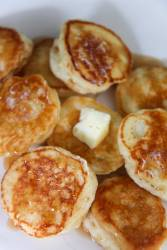 silver dollar pancakes with butter and syrup.