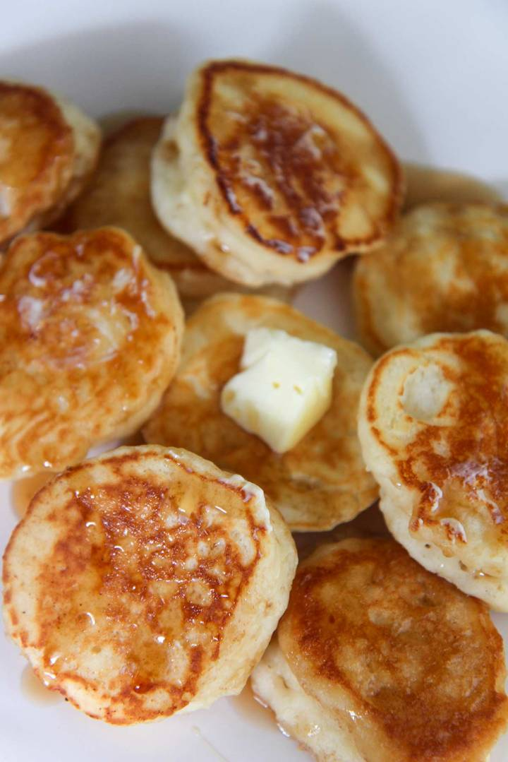 silver dollar pancakes with syrup and butter.