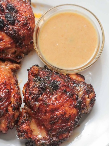 air fryer chicken thighs with a side of honey mustard.