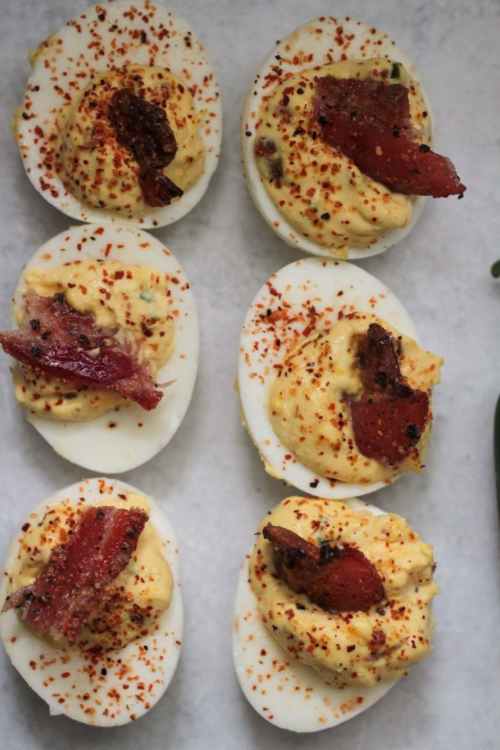 six candied bacon jalapeno deviled eggs.