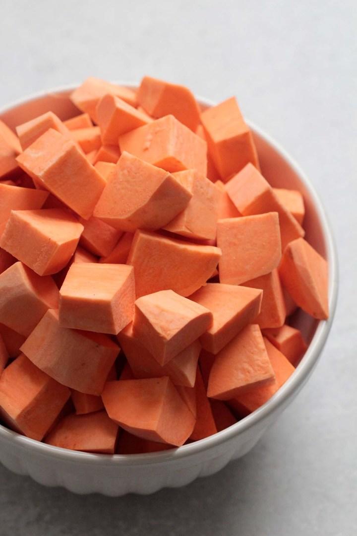 sweet potato cubes in a white bowl.
