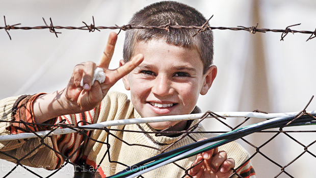 A Syrian refugee flashes a victory sign at Reyhanli refugee camp in Hatay province on the Turkish-Syrian border March 31, 2012. REUTERS/Osman Orsal