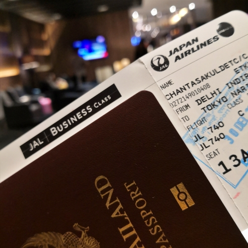 jal-japan-airlines-business-class-review-passport-boarding-pass