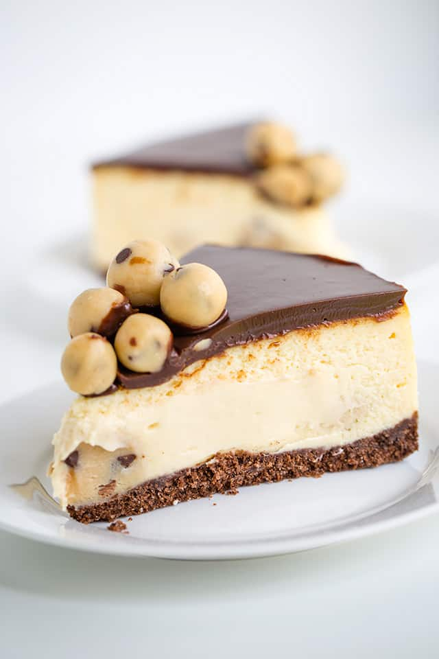 slice of salted caramel cookie dough cheesecake on a white plate