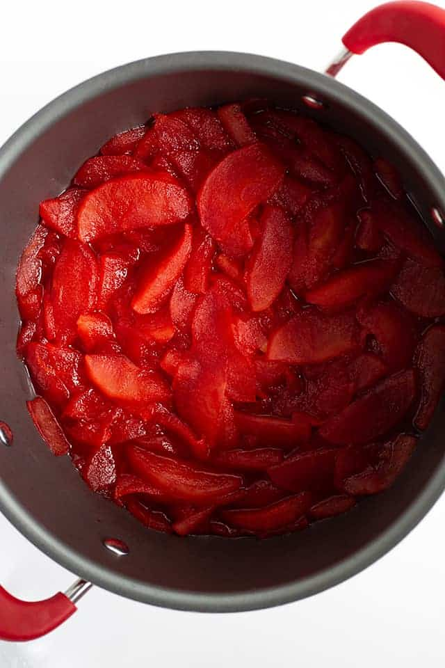 simmered red hot applesauce in a large saucepan