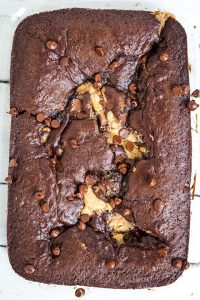 overhead photo of baked chocolate peanut butter earthquake cake showing peanut butter and chocolate chips