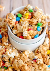 small bowl overflowing with caramel chex mix
