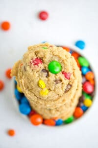 overhead photo of monster cookies sitting on M&M's